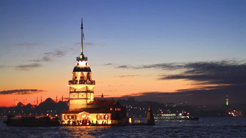 Istanbul Maidens Tower (KIZ Kulesi) from the east in sunset. In the distance are