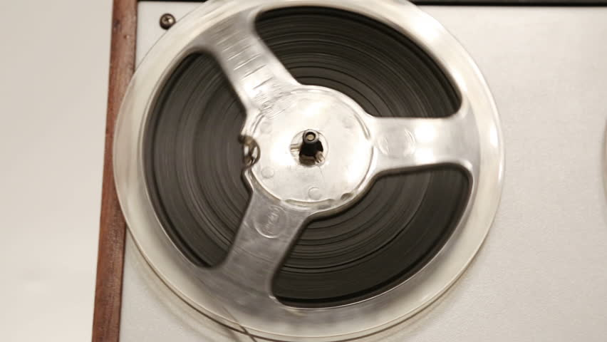 old reel tape recorder with spinning reels - dolly shot