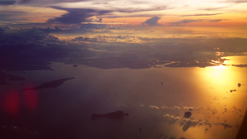 View through airplane window on clouds - HD stock footage clip