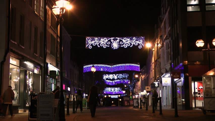Stafford, England - Circa 2013: English Street with Christmas Lights and Pedestrians Shopping - HD stock footage clip