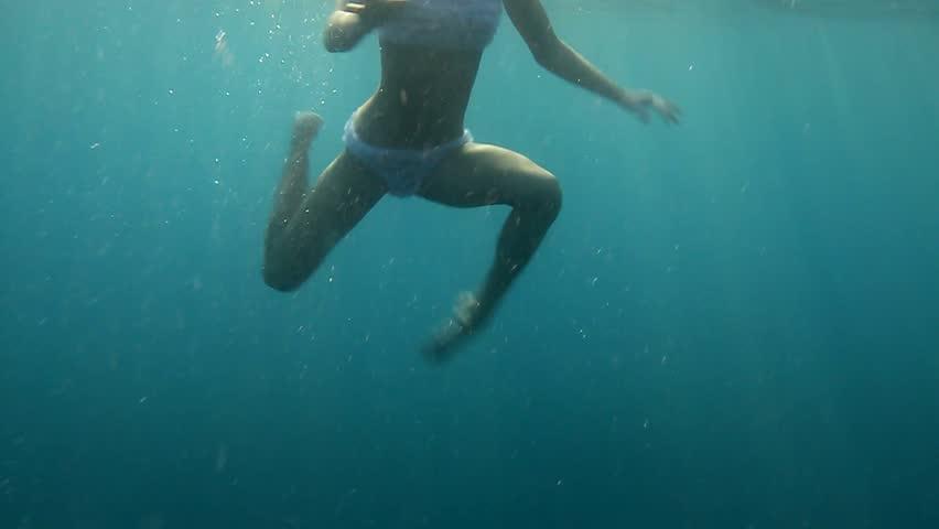 Naked teen boy in ocean