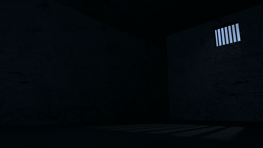 A Slow Pan Of An Empty Dark Jail Cell With Light Rays