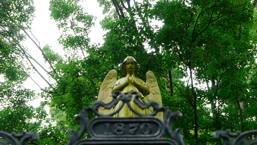 Angel Praying Behind Gate - HD stock video clip