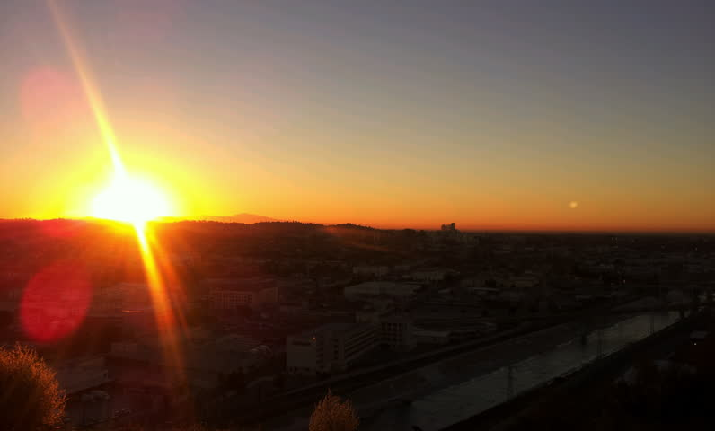 Los Angeles, California - November 13, 2013 - Timelapse of the sun rising over East Central Los Angeles.
