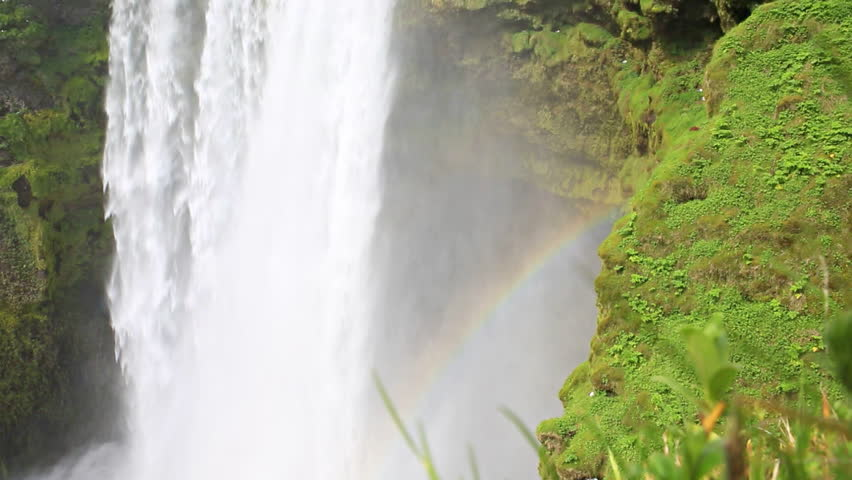 Closeup of skogafoss waterfall and rainbow on the South of Iceland near the town Skogar - HD stock footage clip