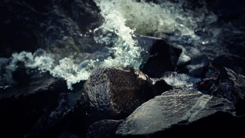 Water splashing against rocks (super slow motion) - HD stock footage clip