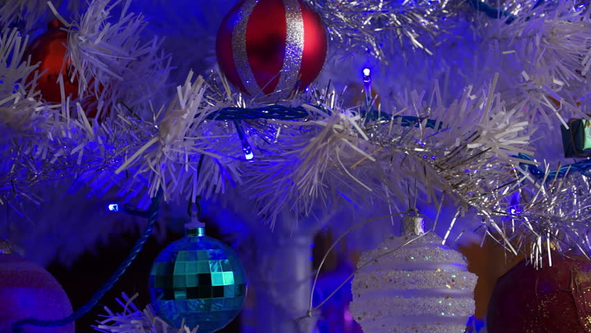 White Christmas tree: tilt up to the Star. Blue cast. - HD stock video clip