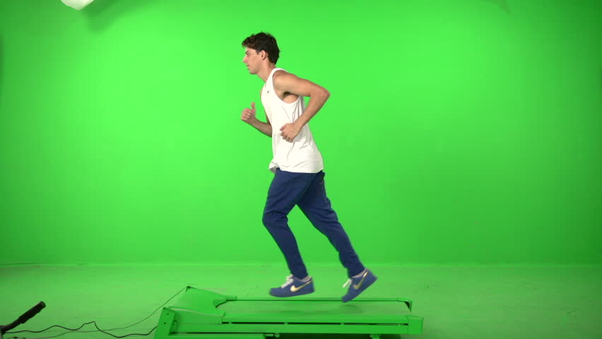 Man runing on a green screen backround | Shutterstock HD Video #5226260