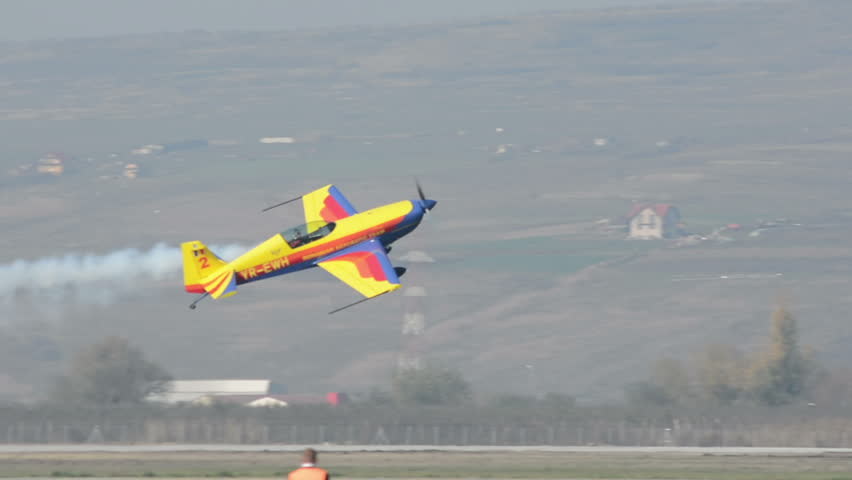 Aerobatic plane does powerslide at low altitude