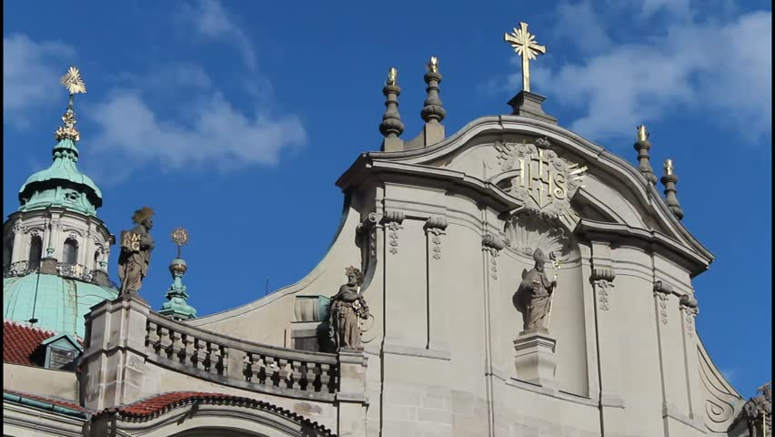 clouds over the church, religious holidays, Church of St. Nicholas in Prague in Europe - HD stock footage clip