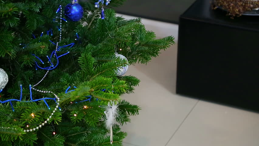 Christmas tree being decorated by a young girl with red hair  - HD stock video clip