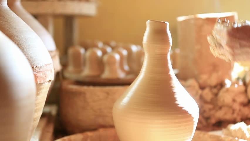Finishing vessel on pottery wheel