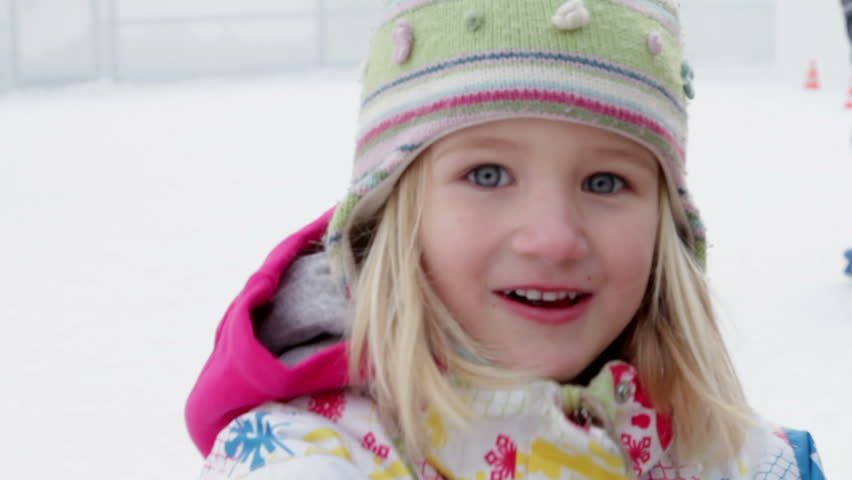 Close shot of little girl waving into the camera - HD stock video clip