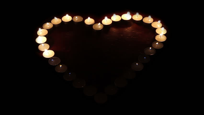 Flammable Heart. Heart shaped candles light up one by one