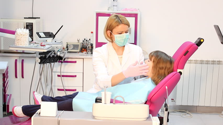 dentist examines teeth a little girl - HD stock footage clip