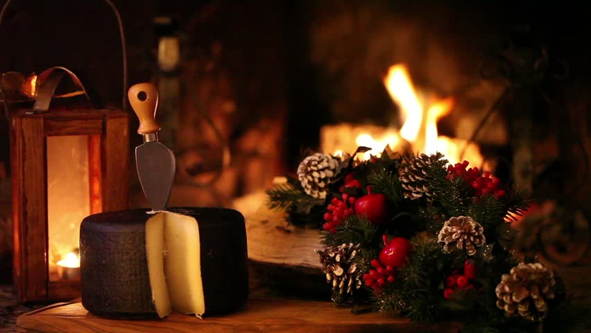 Christmas Snack In Front Of The Fireplace - Video clip of nice Christmas scene in front of the fireplace, showing typical Italian seasoned cheese and Christmas decorations.