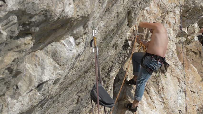 rock climber on limestone wall in Turzii Gorge, Transylvania, Romania - HD stock footage clip