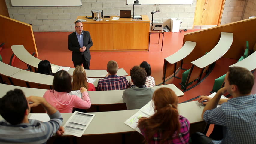 Lecturer speaking to his class in the lecture hall at the university