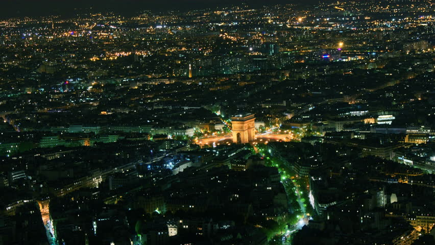 Etoile , where the Arc de Triomphe is located seen from Eiffel Tower, time-lapse night,4k - 4K stock footage clip