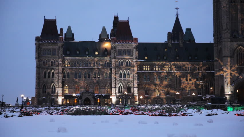The Canadian Parliament Centre Block Building With A Christmas Themed Light Show At Early Evening Twilight In Ottawa Canada