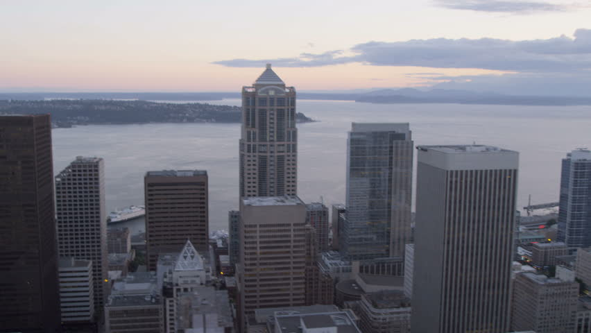 Aerial dusk view of modern city skyscrapers Seattle Business Center major Pacific Seaport, Puget Sound, Pacific Northwest, Washington, USA RED EPIC, 4K, UHD, Ultra HD resolution | Shutterstock HD Video #5300420