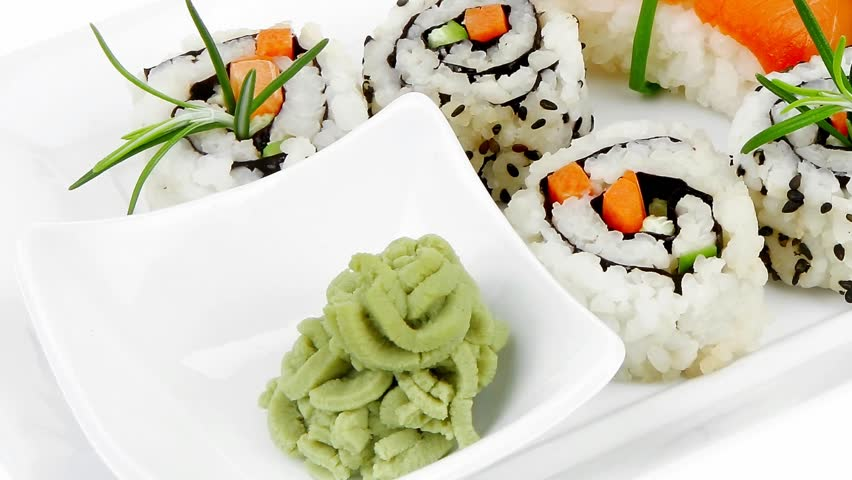 Maki Rolls and California rolls made of fresh raw Salmon Tuna and Eel with Cream Cheese and Avocado . Isolated . on long white plate . Maki Sushi and Nigiri 1920x1080 intro motion slow hidef hd