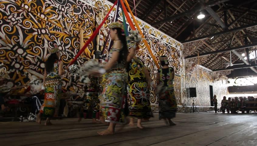 SAMARINDA, INDONESIA. CIRCA November 2013: Traditional Indonesian Dancers from Borneo (Pampang Village) perform the Tari Sakai Nyelamai,Tari Ajay, Tari Enggang Terbang and Tari Berburu - HD stock footage clip