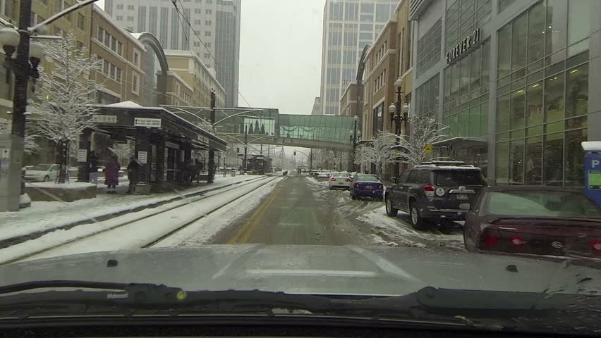 SALT LAKE CITY, UTAH DEC 2013: Economic and business downtown. Snow storm POV HD. Winter snow storm hit West extreme cold weather and snow. Dangerous driving conditions on snow packed and icy roads - HD stock footage clip