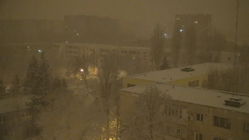 Snowing in Night, Snow Fall, Christmas Scene, Winter View in Town, District - HD stock video clip