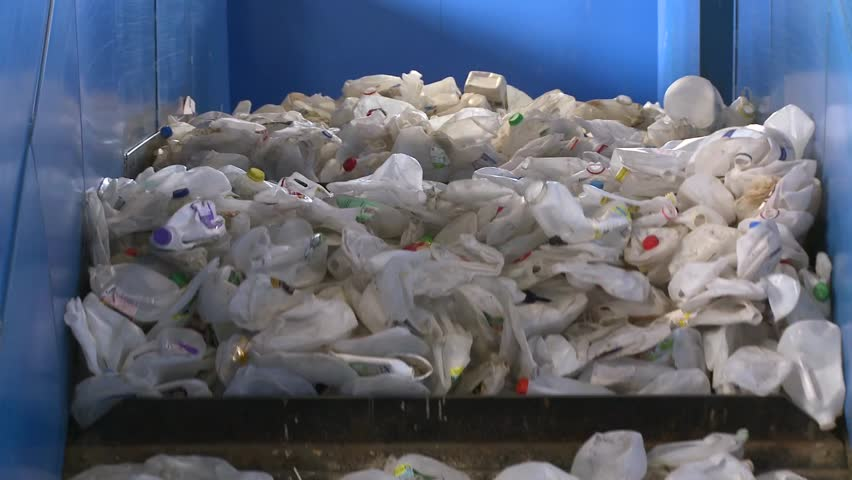 Close up of recyclables on a cleated conveyor (3 of 8) | Shutterstock HD Video #5363384