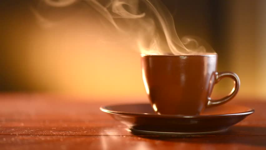 Coffee or Tea. Brown Cup of hot beverage with Steam. Espresso Coffee closeup. HD video Footage #5365670