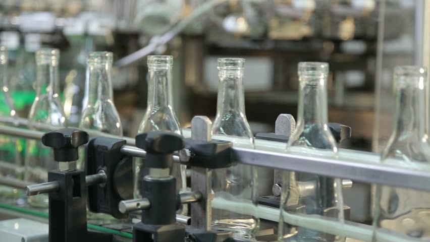 empty transparent bottles for cognac - HD stock footage clip