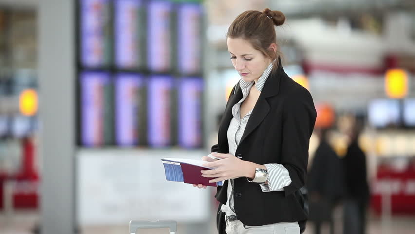 Pretty, young  businesswoman waiting for her flight on an airport