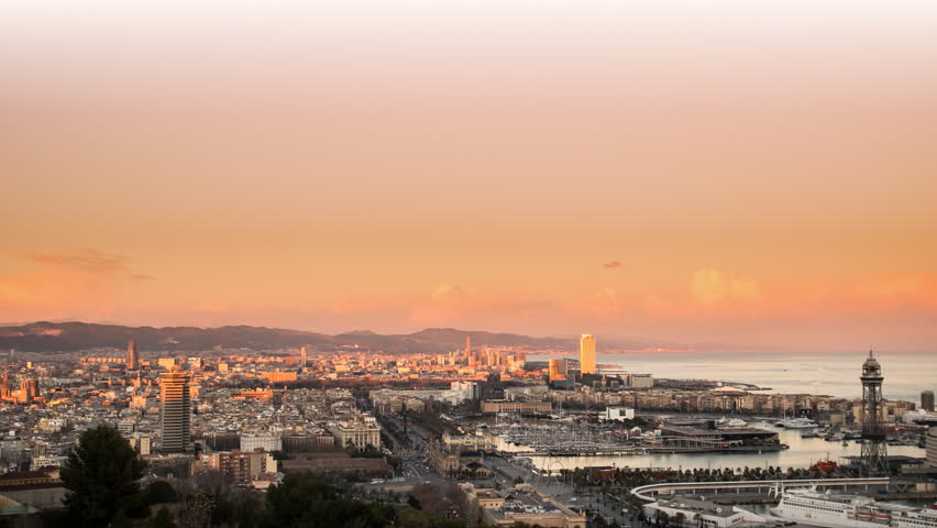 barcelona skylinel view,time lapse from sunset to night with city lighting up