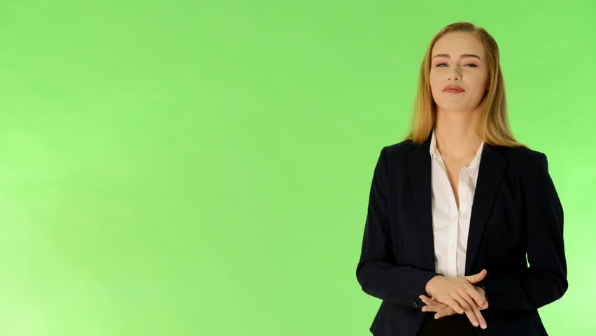 Young business woman presenting something by a hand. On green background.