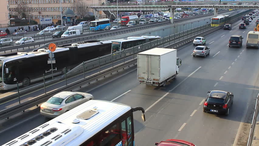 ISTANBUL - DECEMBER 14, 2013: City traffic on Avcilar bus stop. Metrobus line planed as a solution to transport problem with a daily capacity of 800,000 passengers day.  - HD stock video clip