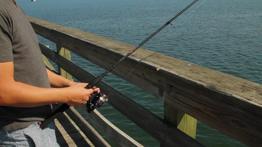 Man fishing off pier stock footage video 5396783 for Fishing off a pier