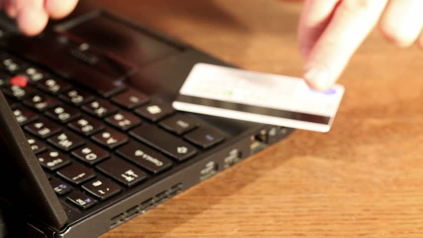 Online  banking and shopping through a credit card - HD stock video clip