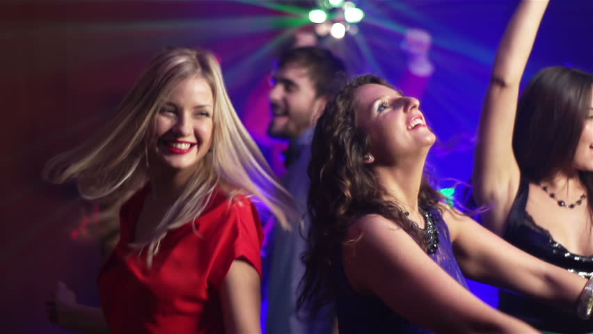 Slow-motion of carefree girls dancing in the nightclub - HD stock video clip