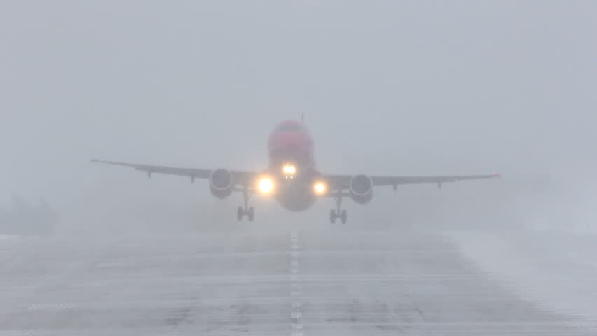 Airliner taking off during a blizzard.