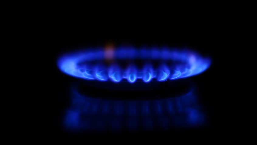 Natural gas inflammation in stove burner, soft focus, dark shot, turning on and off, switching gas on and off (HD, high definition 1080p) - HD stock video clip