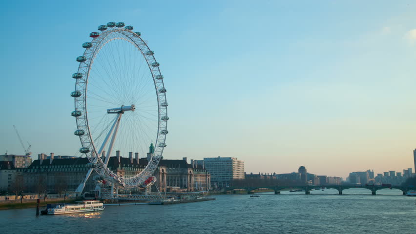 Time lapse of the River Thames in London in the last hour before sunset in February 2012. Boats move up and down the River Thames by Westminster Bridge as the London Eye rotates. 4K version - 4K stock video clip