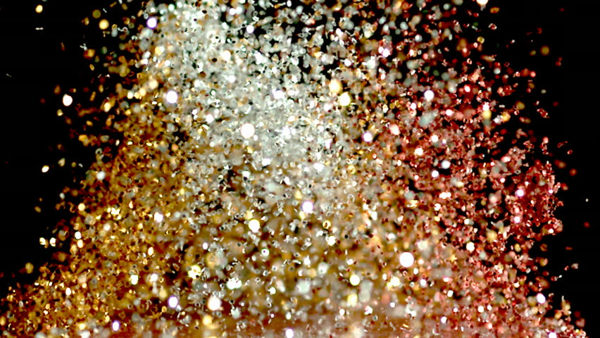 glitter exploding into a rainbow of colors slow motion - HD stock footage clip