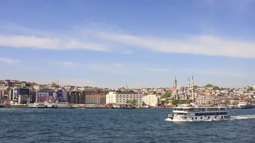 ISTANBUL - MAY 23, 2013: Passenger ships connect Galata Bridge with the Asian suburbs of Uskudar and Kadikoy. Ferryboats are the absolute most enjoyable way to travel in Istanbul.