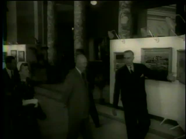 President Dwight Eisenhower with First Lady, attends an exhibition of Winston Churchill paintings, Washington D.C. circa 1958 - MGM PICTURES, UNIVERSAL-INTERNATIONAL NEWSREEL, USA, filmed in 1958