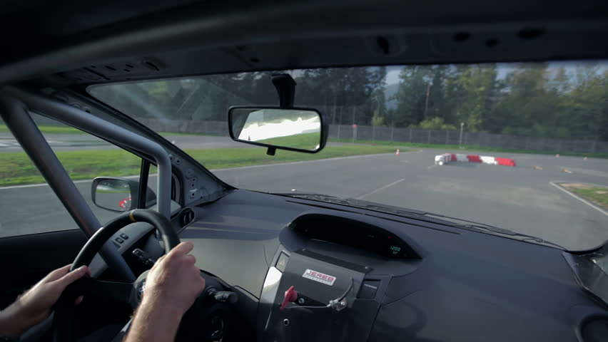 VRANSKO, SLOVENIA - SEP 2013: Driver of a sports car driving through simulation of extreme road conditions. Go-cart and cars simulations event. - HD stock video clip