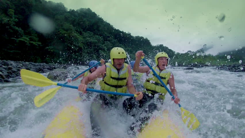 Team of six people white water rafting. On board camera. | Shutterstock HD Video #5469224