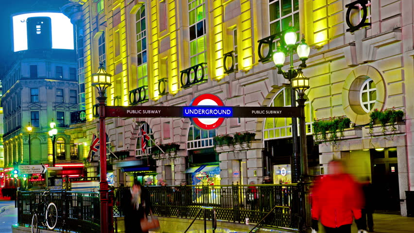 4K Amazing London Piccadilly circus underground sign Quad Ultra HD hyper time lapse. Timelapse movie of the bright lights of Piccadilly Circus in London, at night