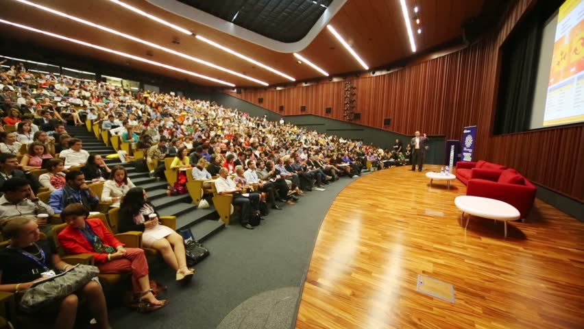 MOSCOW, RUSSIA - AUG 20, 2012: Speaker and audience at Global Youth to Business forum in congress-hall of Moscow School of Management Skolkovo.