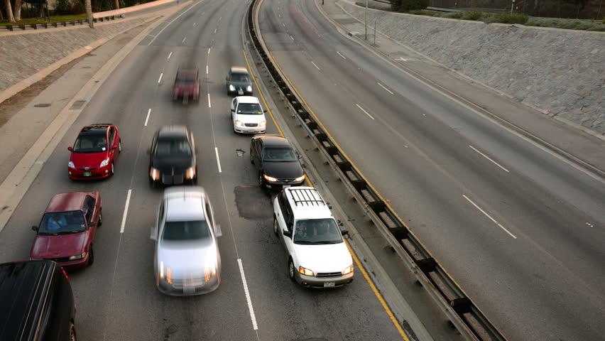 Highway Traffic 27 Tilt Down Timelapse Highway Sunset - 4K stock video clip
